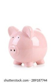 Pink piggy bank isolated on a white