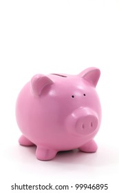Pink piggy bank isolated on white.