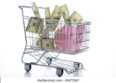 a pink piggy bank and money in a shopping cart, isolated on white with room for your text or images. Represents Shopping for a bank, or home loan, or interest rate or high cost of shopping and goods