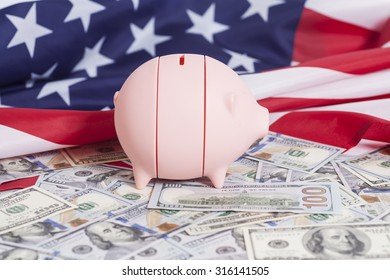 Pink Piggy Bank on Dollars with American Flag