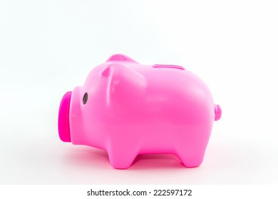 Pink piggy bank saving on white background.