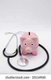 Pink piggy bank and stethoscope