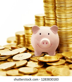 pink piggy ceramic bank with many golden coins, money saving