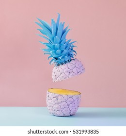 Pink pineapple on yellow background. Minimal style. Food concept.