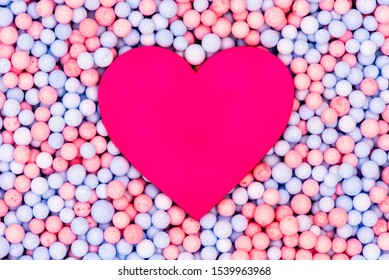 Pink plastic Heart in the middle Pastel color Circle ball Styrofoam or Polystyrene foam texture background