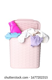 Pink plastic laundry basket and cleanser isolated on white