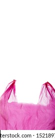 Pink plastic shopping bag isolated on white background. Plastic shopping bag in motion.