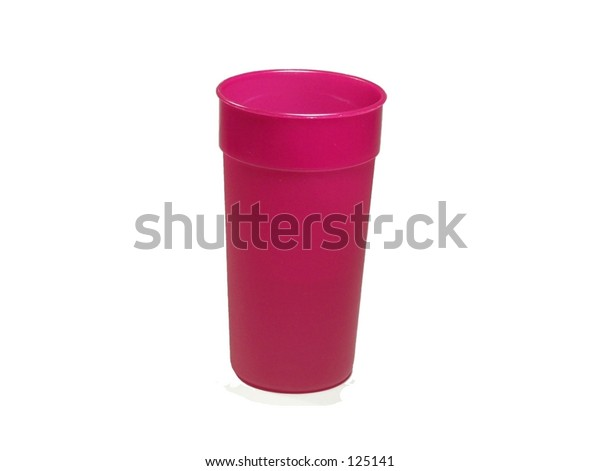 Pink plastic water glass on white background