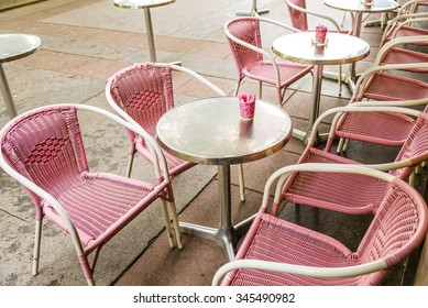 Pink Plastic Wicker Chairs And Round Silver Tables With Pink Cups  Containing Sugar Outside A Bistro