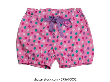 Pink polka dot shorts. Isolate on white.