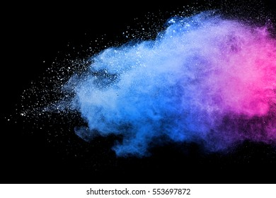 Pink powder explosion on black background. Colored cloud. Colorful dust explode. Paint Holi.