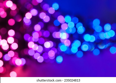 Pink, purple and blue defocus lights abstract background.