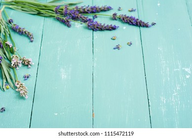 pink and purple lavender flowers on blue wood table background