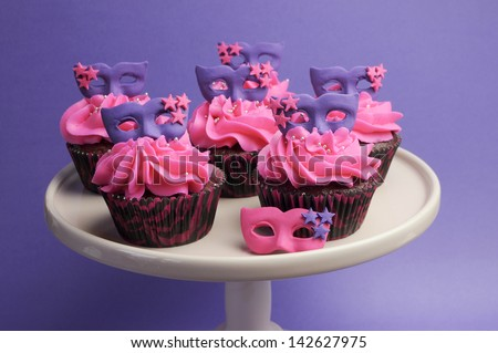 bb2793e79754 Pink and purple masquerade masks decorated party cupcakes with pink  frosting for Mardi Gras