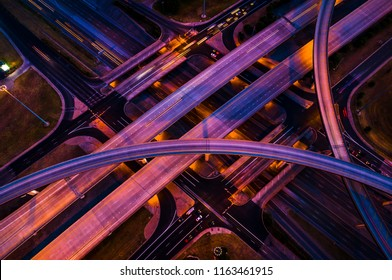 Pink and purple nightscape night driving city at night - Highway interstate 35 overpass and interchange transportation driving