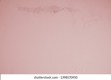 Pink, purple, pink, pastel, concrete wall with dirty, old, rough structure in the upper part of the picture. Stone wall, cement wall in industrial style as background, wallpaper, design element, art