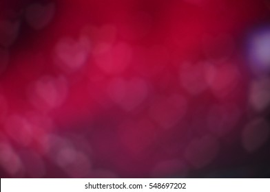 Pink purple red romantic background with hearts bokeh symbol of love Valentine's day flickering light texture Wallpaper