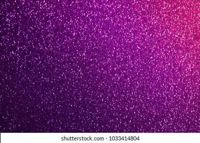 Pink purple and violet lilac glistening sequins. Sequins texture, festive sparkling background.