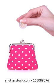 Pink purse and coin in female hand isolated on white