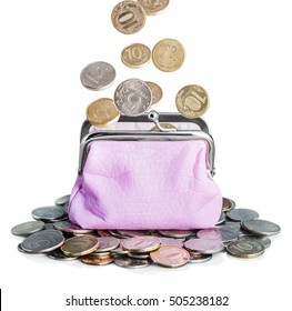 pink purse and coins isolated on white. Coins falling into a purse