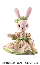 Pink rabbit toy in dress isolated on white background