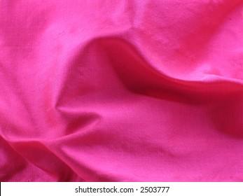 Pink raw silk of a sari swirls for background