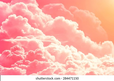 Pink red clouds on sky background