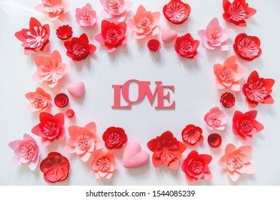 Pink and red flower made of paper. Shape frame place for text. Holiday of all lovers. White background.