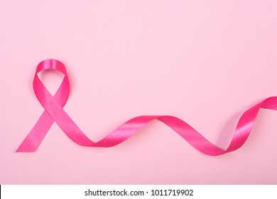pink ribbon breast cancer on pink background. with copy space