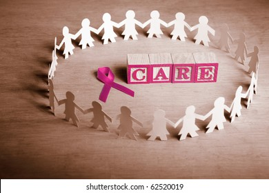 Pink ribbon with word 'Care' surrounded by female paper doll
