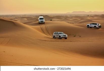 Pink Rock Desert, Sharjah, UAE - OCTOBER 18: Driving on jeeps on the desert, traditional entertainment for tourists on October 18, 2014 in Pink Rock Desert, Sharjah, Dubai, UAE