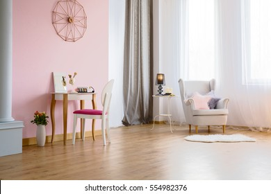 Pink room with dressing table, armchair and column