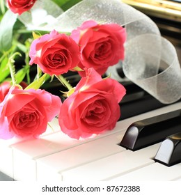 Pink rose bouquet on Piano's key board