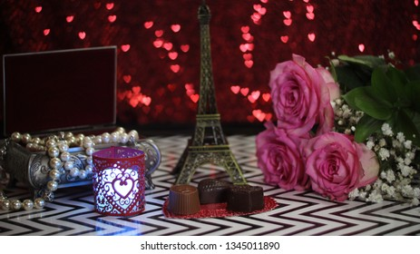 Pink Rose With Eiffel Tower Replica Shallow DOF, Focus on chocolate candy