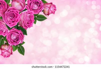 Pink rose flowers in a corner floral arrangement on holiday background