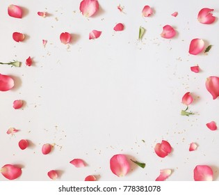 Pink rose petals frame. Flat lay.