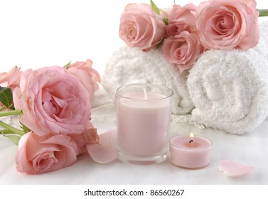 pink rose and roller towel with candle