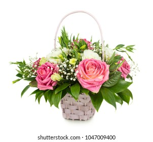 Pink roses basket isolated over white background