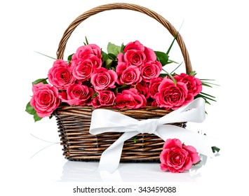 Pink roses in the basket on white background