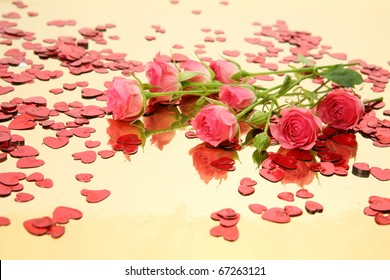 Pink roses and confetti