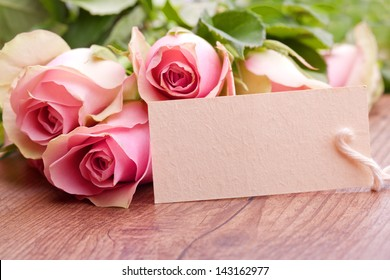pink roses with gift card