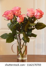 Pink roses in a glass jug