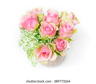 Pink roses and gypsophila in a vase, isolated