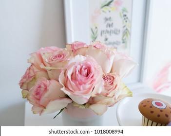 pink roses in marble vase