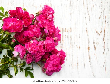 Pink roses on old white wooden background