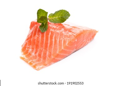 Pink salmon fillet with mint leaves as a garnish