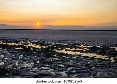 Pink salty Siwash Lake, colored by microalgae, famous for antioxidant properties, enriching water by beta-carotene at sunset