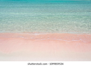 Pink sand and turquoise pristine water one Balos beach  in Crete, Greece