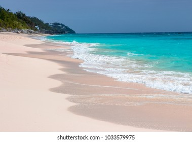 Pink, sandy, tropical beach on the south shore in Warwick, Bermuda with turquoise ocean. Long Bay Beach is relaxing and quiet, the perfect, stress free spot to unwind.