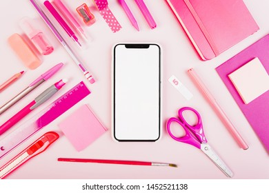 Pink school stationery with phone in center